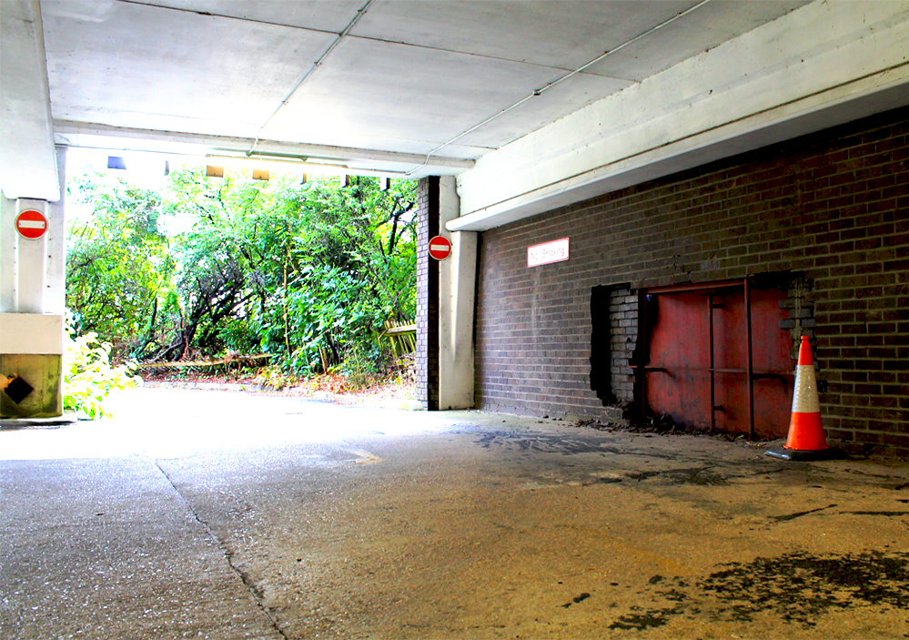 Car Park 5, Bracknell: A section of wall that has been destroyed in the basement level